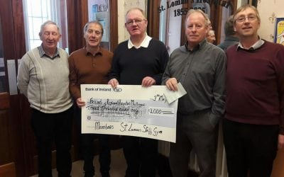 Members of The St. Lomans Gym. making a presentation of €3,000
