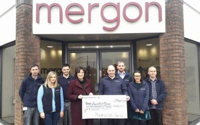Mergon Staff presenting cheque from their Monthly charity Lunch